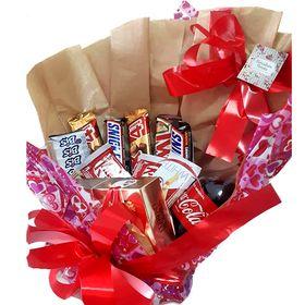 Cesta de doces e chocolates